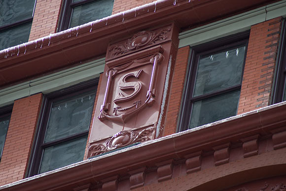 Shields with letters that spell out �Schofield� recreated and line the building