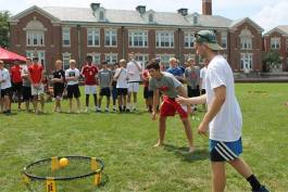 kids playing a game of spikeball