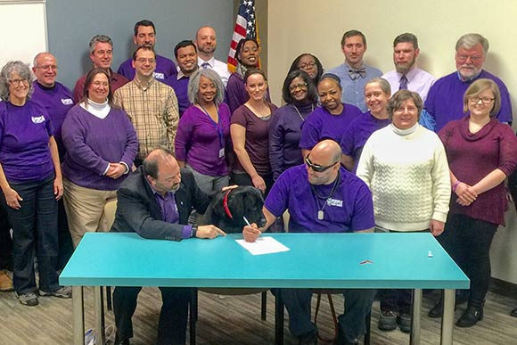 Elyria native Corp. Leo Robinson signed the final closing documents for his new house in South Euclid during a Feb. 18 ceremony at Cuyahoga Land Bank