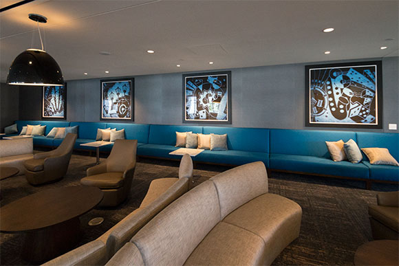 The lounge area of Eliot�s Bar with prints by local artist Paul Duda