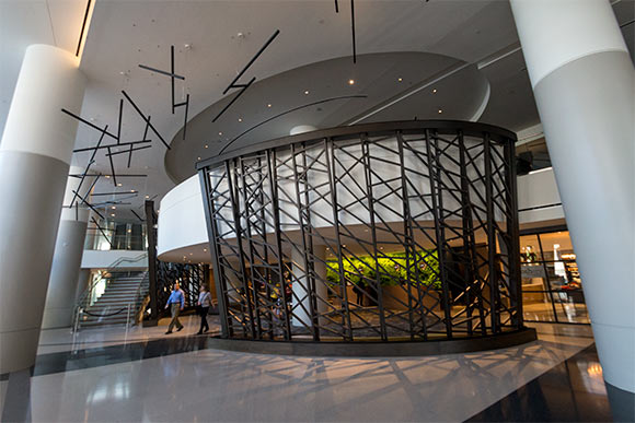 The free-standing powder coated steel wall by public artist Steve Manka in the Hilton lobby