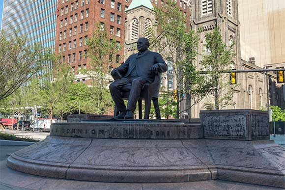 The refurbished statue of 1901 mayor Tom Johnson now sits on the north center section of the square