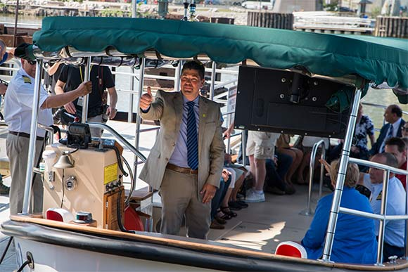 Cleveland Metroparks Chief Executive Officer Brian Zimmerman ready to shove off on the inaugural Water Taxi ride