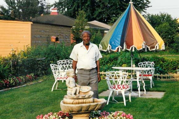 The Late Mr. Connie Walker in his lovely backyard on Myrtle Avenue