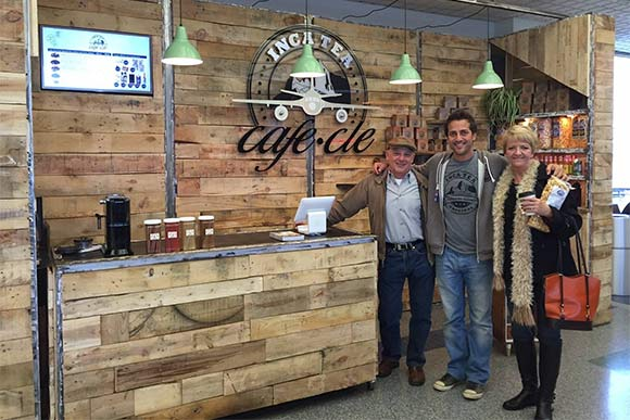 Ryan Florio with his parents in front of Inca Tea shop at the airport