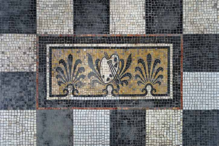 The mosaic tile floor restored on the art gallery front porch