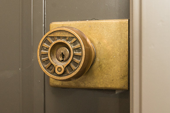 Original train wheel door knobs in the Architectural detail inside the Standard Building