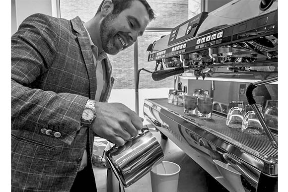 Trevor Gile one of the owners of Daylight Donuts & Coffee