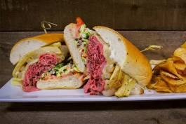 The Pittsburgh dish: A Pittsburgh style beef sandwich, shaved strip loin, provolone, fries, slaw tomato and creamy horseradish