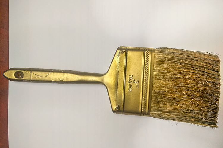 The golden paintbrush  retired from painting projects used to paint homes throughout the community by volunteers and then decommissioned and turned into works of art