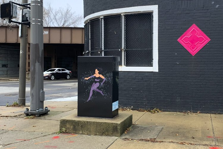 "The utility box wrap at Payne Avenue and East 40th Street, titled ""Swimming"" by Julia Kuo."