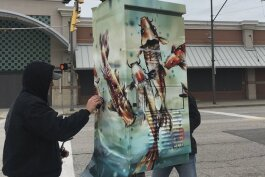 "The utility box wrap titled ""Happy Koi,"" by Mitzi Lai, at East 33rd Street and Payne Avenue."