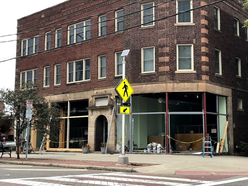 Construction workers hammer away in October on the new home of the UNBar Café.