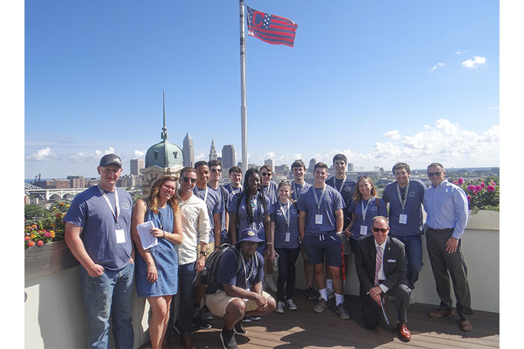 (i)Cleveland students with council member Kerry McCormack on the rooftop of Skyline Financial
