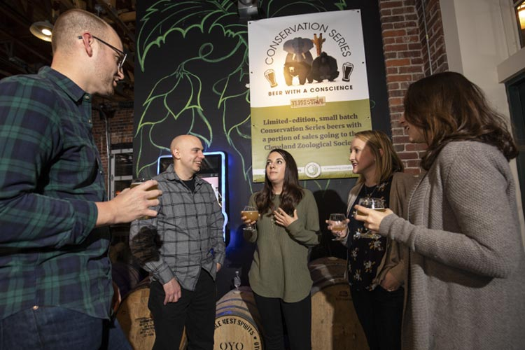 Members of The Herd, the young professionals group of the Cleveland Zoological Society, attend the kick-off party at Terrestrial