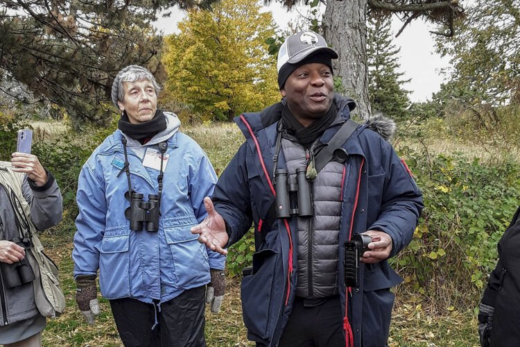 David Lindo talks to the Cleveland Lakefront Tour birders at Cleveland Lakefront Nature Preserve.