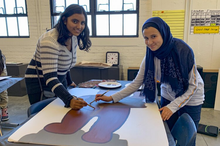 Students Mariam Kalil and Aayushi Shrivastava at Menlo Park Academy make signage this year for the Giant Eagle Market District store in Strongsville.
