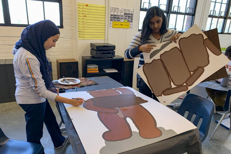 Students at Menlo Park Academy make signage this year for the Giant Eagle Market District store in Strongsville.