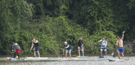 Stand up paddle boarders take off for a 6 mile race on Cuyahoga River at Rivergate Park in Cleveland outside Merwin's Wharf.