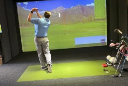 "Robert ""Bunk"" McMahon shows off the Full Swing golf simulator at Proximity Golf Lounge."