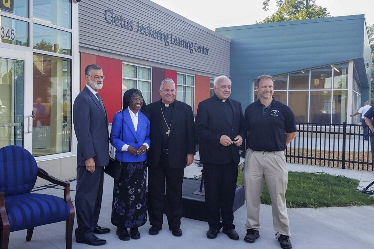An Aug. 20 ribbon-cutting ceremony drew dignitaries to St. Adalbert Catholic School.
