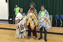 Graduates receiving blankets from LENAC at the 2019 Pow Wow.