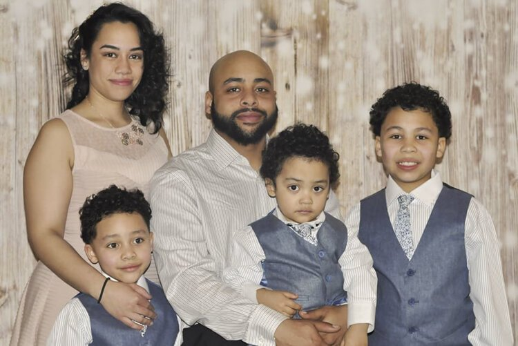 Tanisha Velez with her fiancé and three sons.