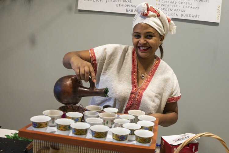 Tigist Gebremichael preparing coffee from a vassel (Jebna) last December 2019 at a pop up in Rocky River.