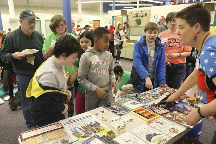 Lake Erie Ink co-founder Cynthia Larsen, far right, answers questions at Kids' Comic Con.