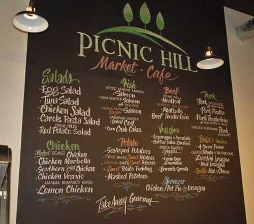 The Picnic Hill menu features a playful approach to gourmet food.