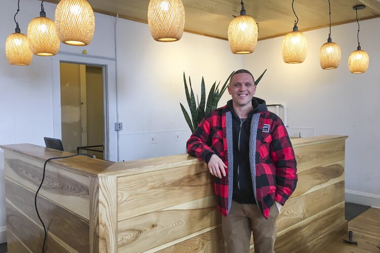Peter Brown shows off the coffee bar inside the new Six Shooter space.