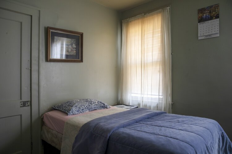 A simple and comfortable bedroom is provided at the men's shelter across the street from the Manna House.