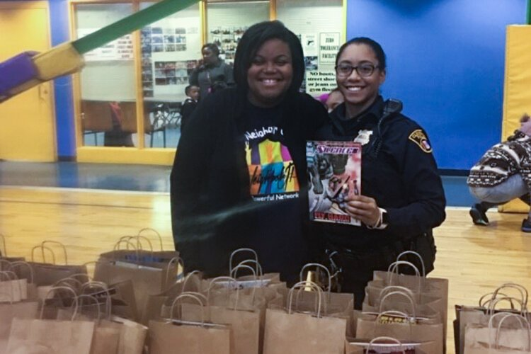 Arrington distributes books at 2018's Big City Boo event, a fun alternative to trick-or-treating.