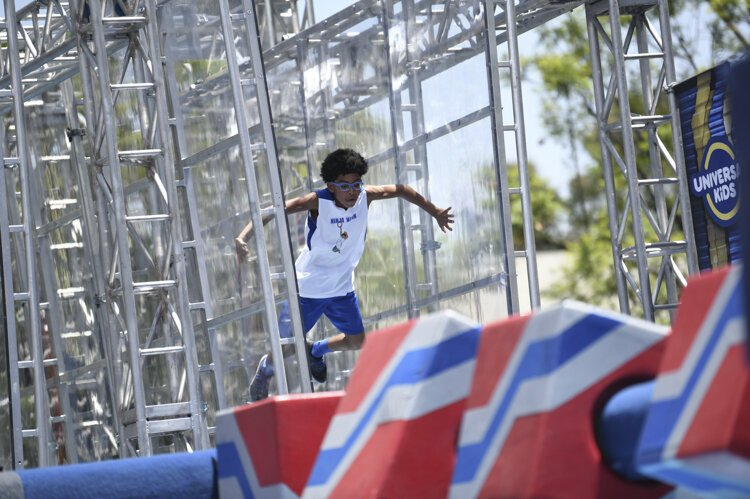 Nathanael Honvou  competing in age group 9-10 on American Ninja Warrior Junior - Season 2.