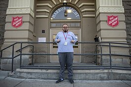 Wilber Argueta stands outside the Zelma George Salvation Army Shelter, where he helped organize online tutoring for 12 homeless youth this summer.