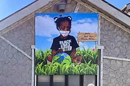 New mural by artists Darin Gooch, known as Shakir and Sampson Smiley known as Sampson the Artist.