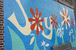 Joy mural at Lee Road and Silsby Road, SE corner in Cleveland Heights