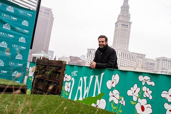 Tom Starinsky at the Lawn, a pocket park next to SmallBox and boasts furniture made from salvaged materials