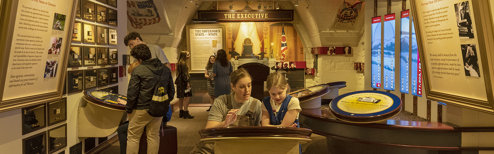 Monica and Bailey Craven explore interactive exhibits at the Ohio Statehouse Museum Education Center. <span class=&apos;image-credits&apos;>Gary Kessler</span>