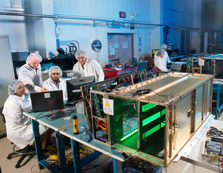 A team of scientists and engineers test the components of Saffire