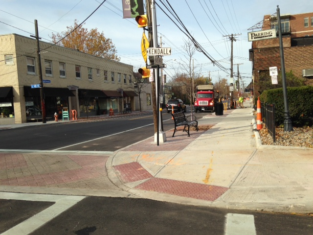 Larchmere streetscape with decorative brick crosswalks